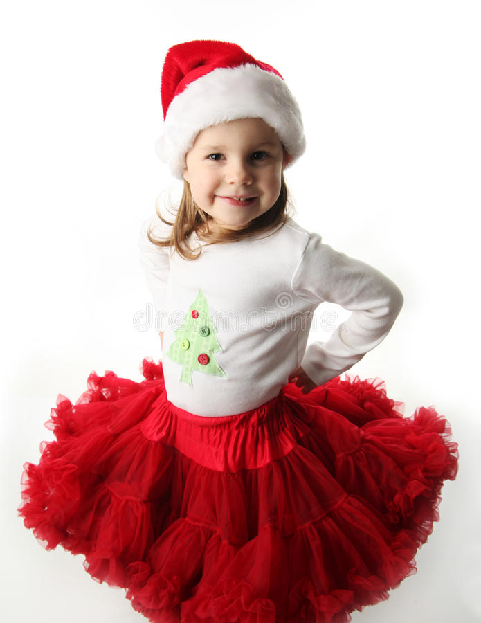 Kleines Mädchen tragender Weihnachtssankt-Hut und Rock stockbilder
