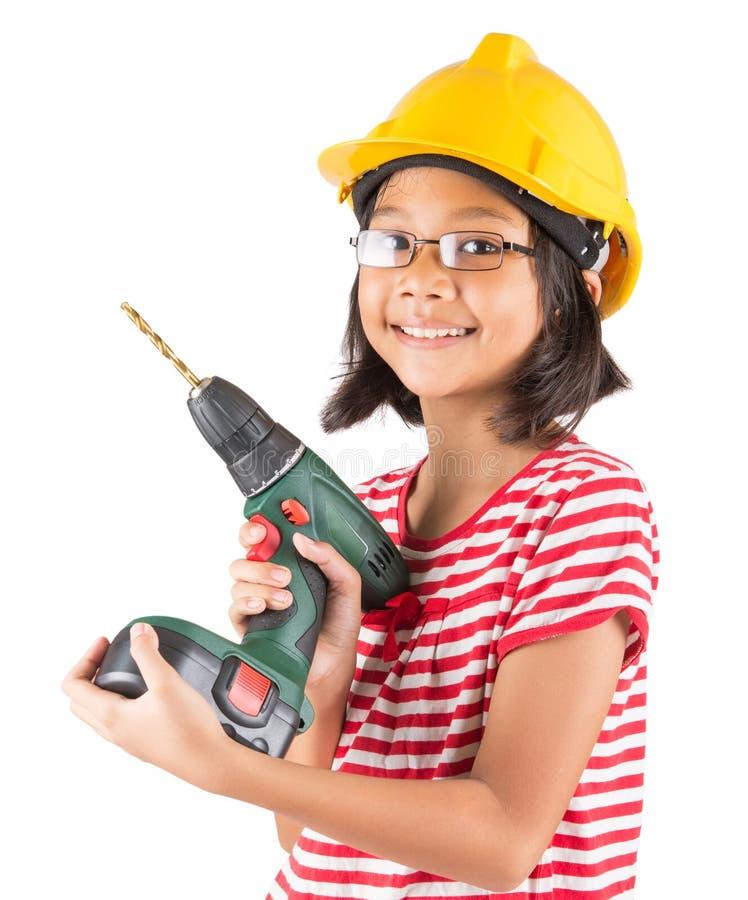 Kleines Mädchen und Bohrmaschine II stockfotografie