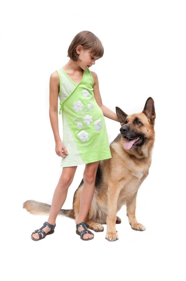 Kleines Mädchen und Hund stockbild