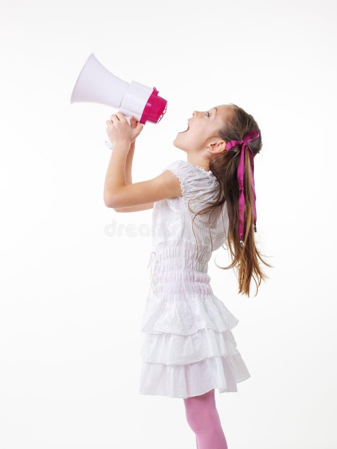Kleines Mädchen und Megaphon lizenzfreie stockfotos