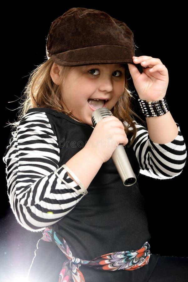 Kleines singendes Mädchen stockbilder