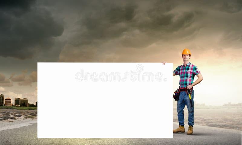 Kleinhandelaar met banner stock foto's