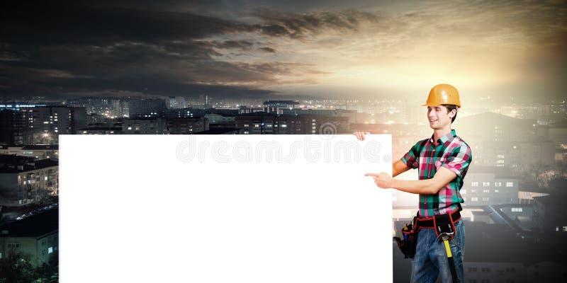 Kleinhandelaar met banner stock foto