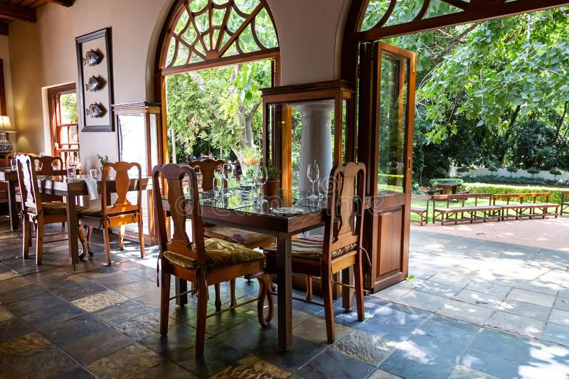 Kleinkaap Hotel in Centurion South Africa. Pretoria, South Africa, 11 February - 2019: Interior view of hotel restaurant area with view to gardens outside stock photography