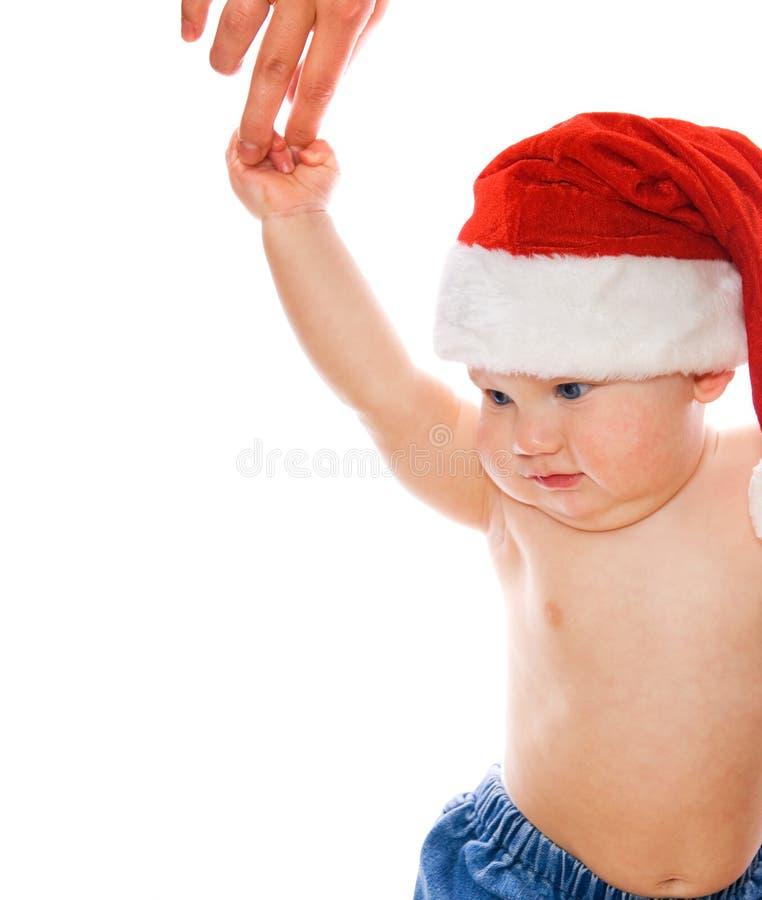 Kleinkind im Weihnachtshut lizenzfreie stockfotografie