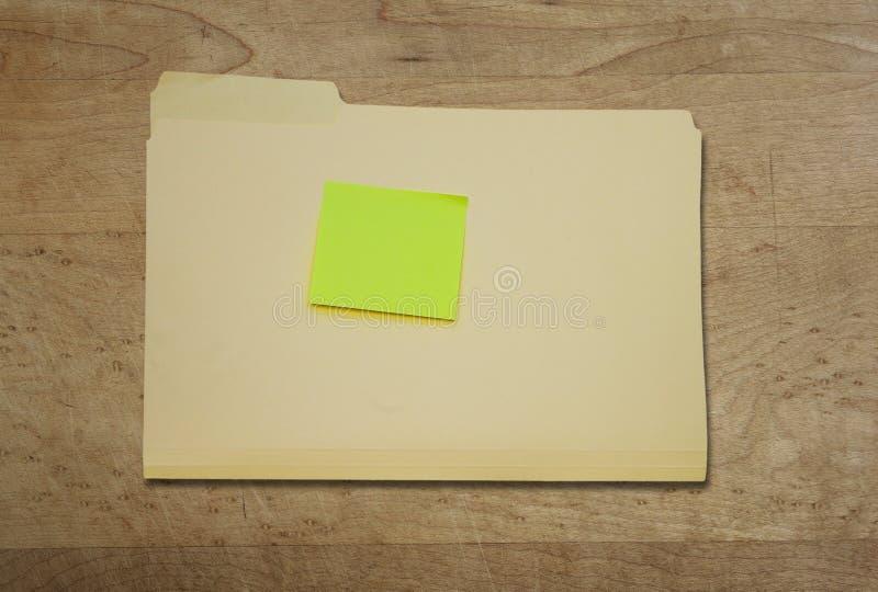 Kleista notatka na falcówce fotografia stock
