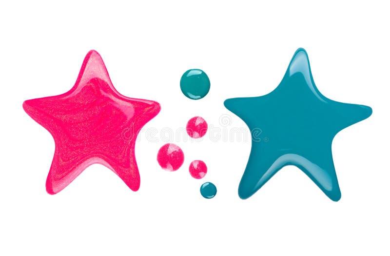 Kleksy lub kapinosy gwoździa połysk w postaci gwiazdy zdjęcie royalty free