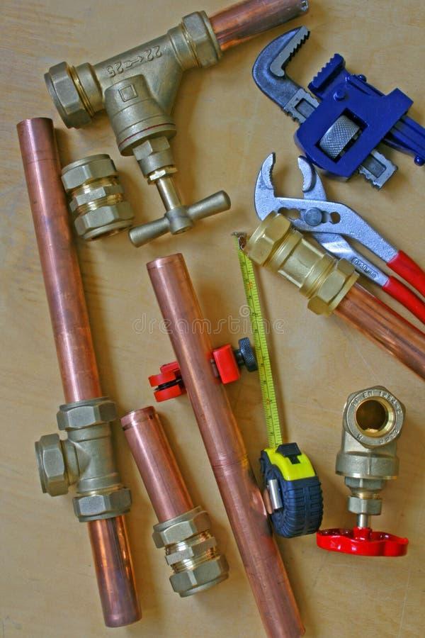 Klempner ` s Rohre und Installationen lizenzfreie stockbilder