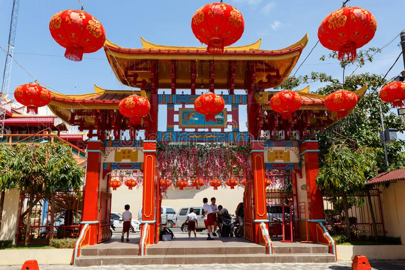 Klenteng Kwan Kong, Manado Indonesia. Manado, Indonesia - August 04 2015: Gateway to Klenteng Kwan Kong Temple courtyard, one of the oldest temple in Manado stock photos