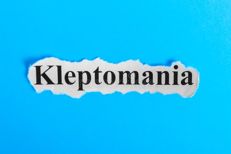 Kleptomania text on paper. Word Kleptomania on a piece of paper. Concept Image. Kleptomania Syndrome.  royalty free stock photo