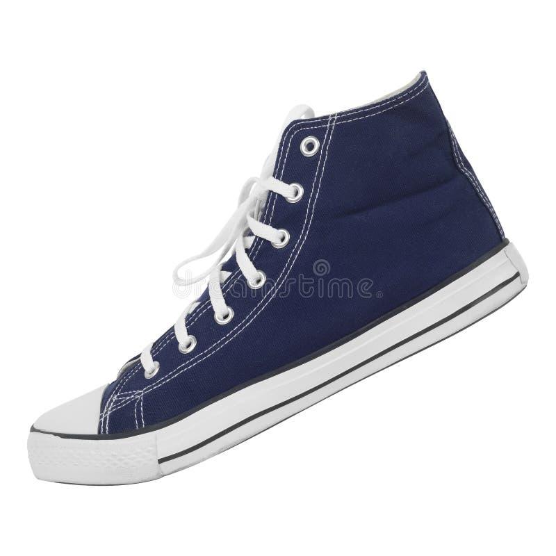 Kleren, schoenen en toebehoren - zijaanzicht één blauwe geïsoleerde gumshoes stock foto