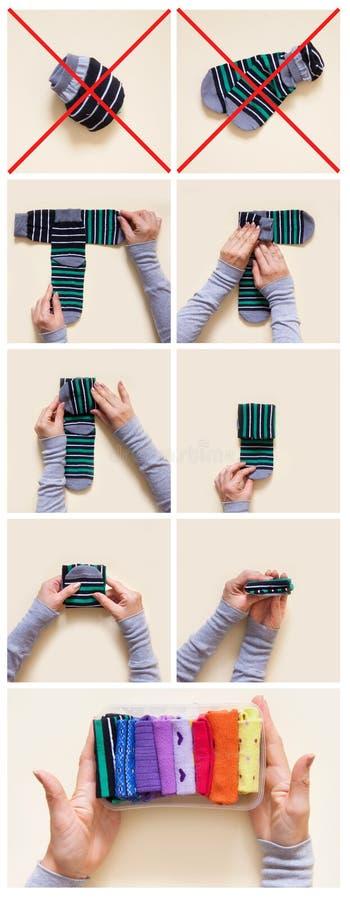 Klerenopslag Orde in de kast Het vouwen van sokken Hoofdclas stock afbeeldingen