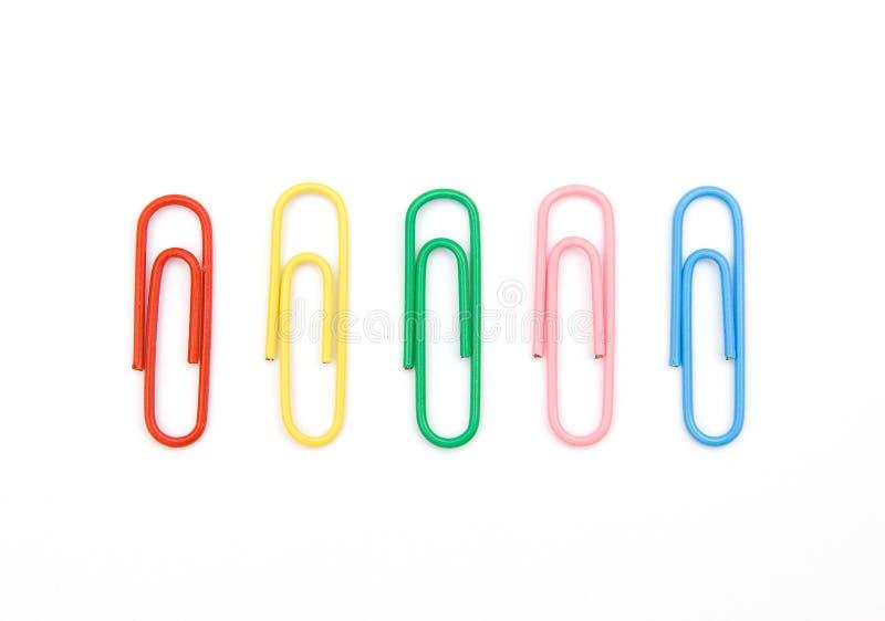 Kleur vijf paperclips stock fotografie
