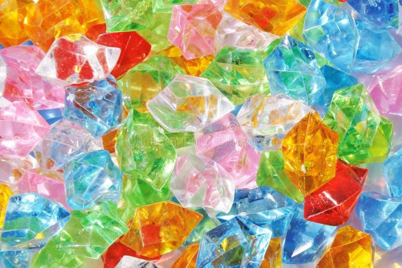 kleuren plastic diamanten stock fotografie
