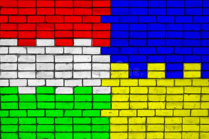 Kleuren van nationale vlaggen van Hongarije en de Oekraïne op een bakstenen muur royalty-vrije stock afbeelding