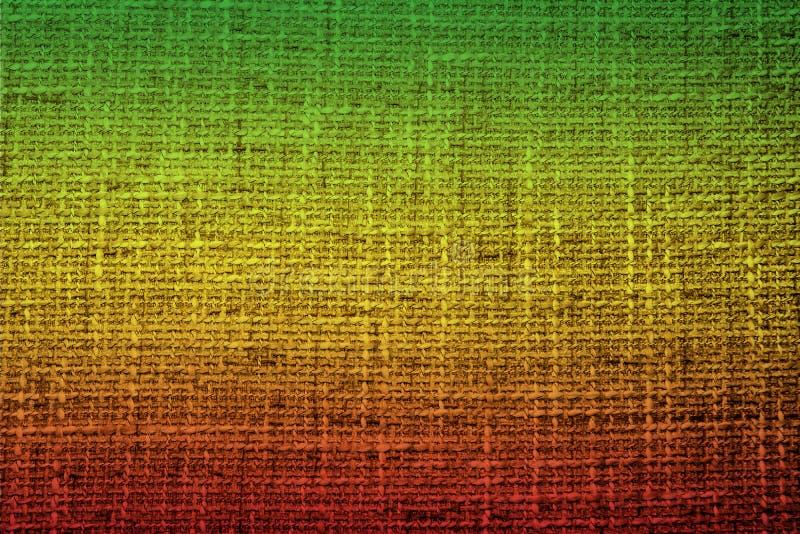 Kleuren van reggae op de stoffenachtergrond royalty-vrije stock foto's