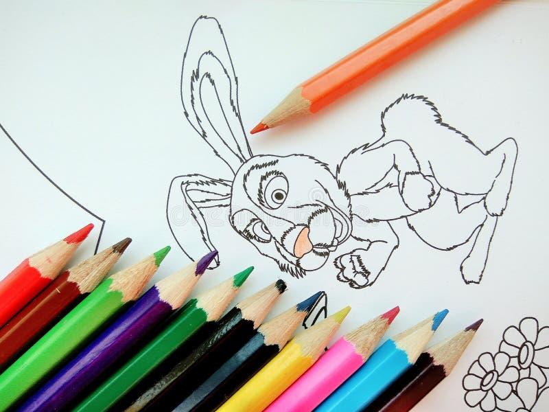 Kleurenboek met kleurrijke potloden stock illustratie