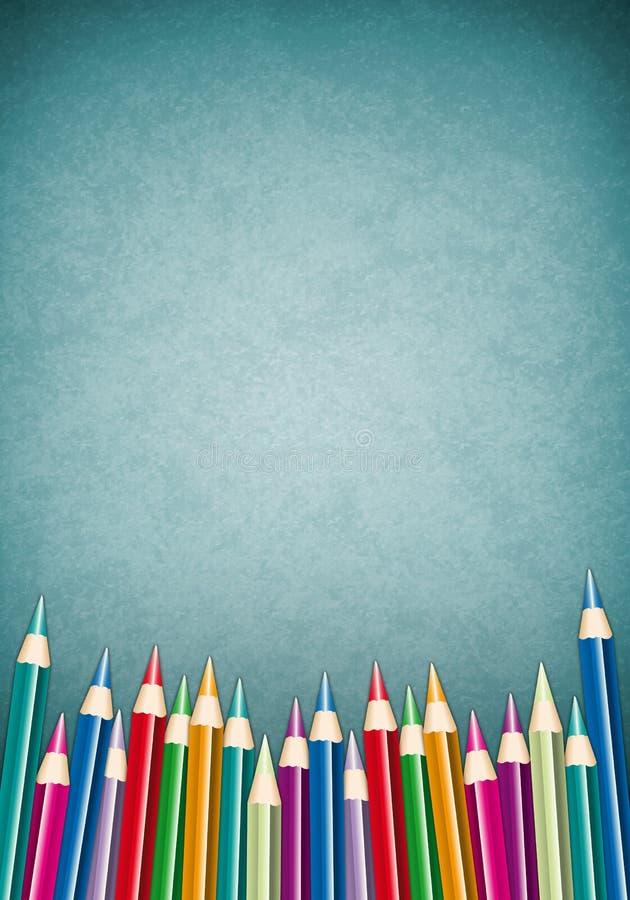 Kleurpotloden op een textuurachtergrond stock afbeelding