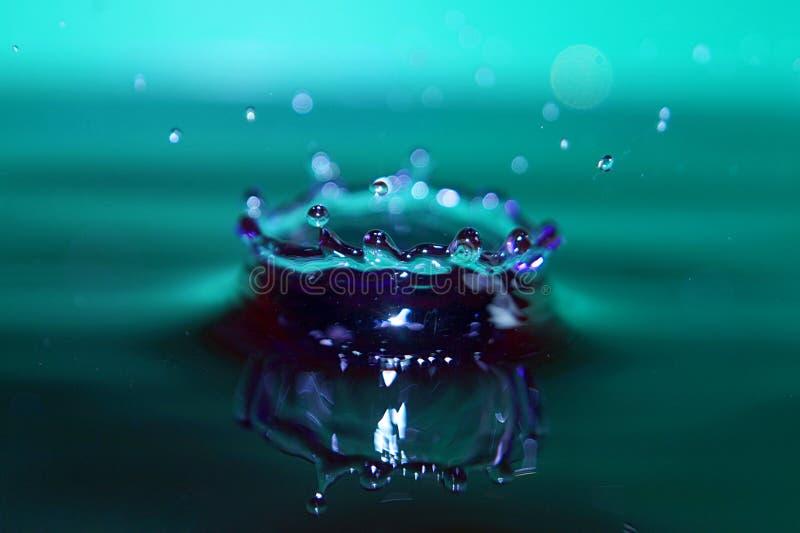 Kleurrijk de plons listig close-up van de Waterdaling royalty-vrije stock afbeelding