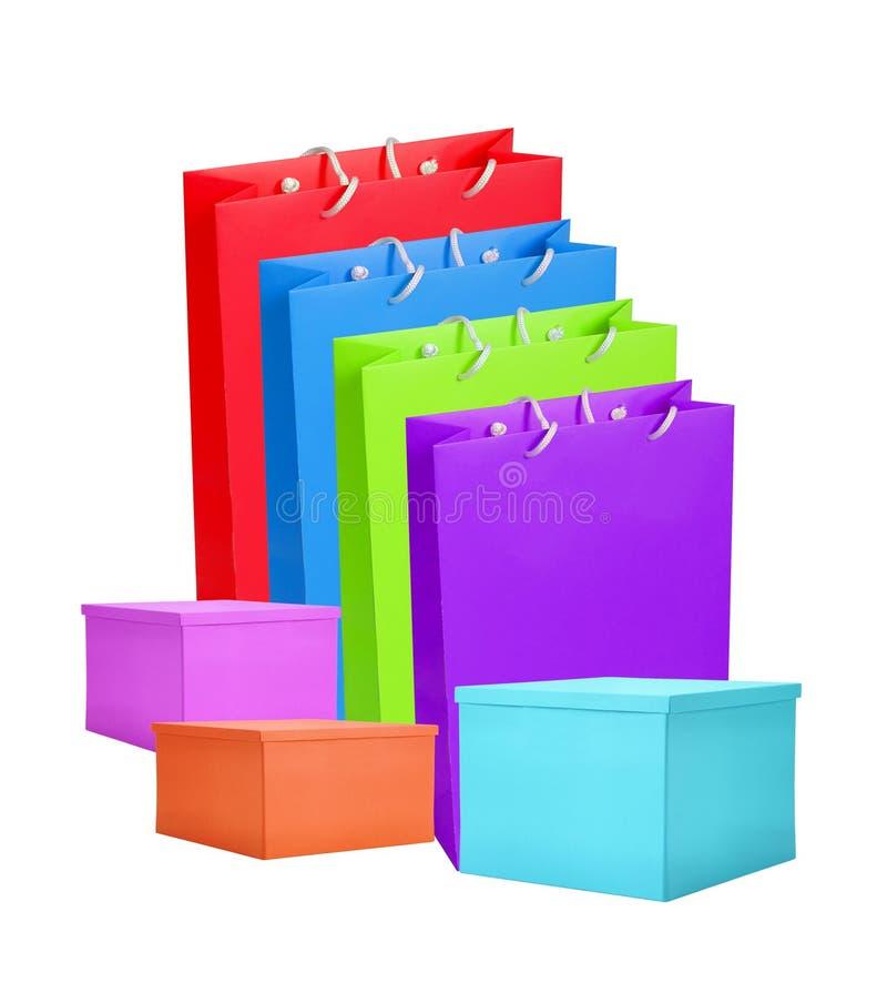 Kleurrijk document het winkelen geïsoleerde zakken en vakje stock afbeeldingen