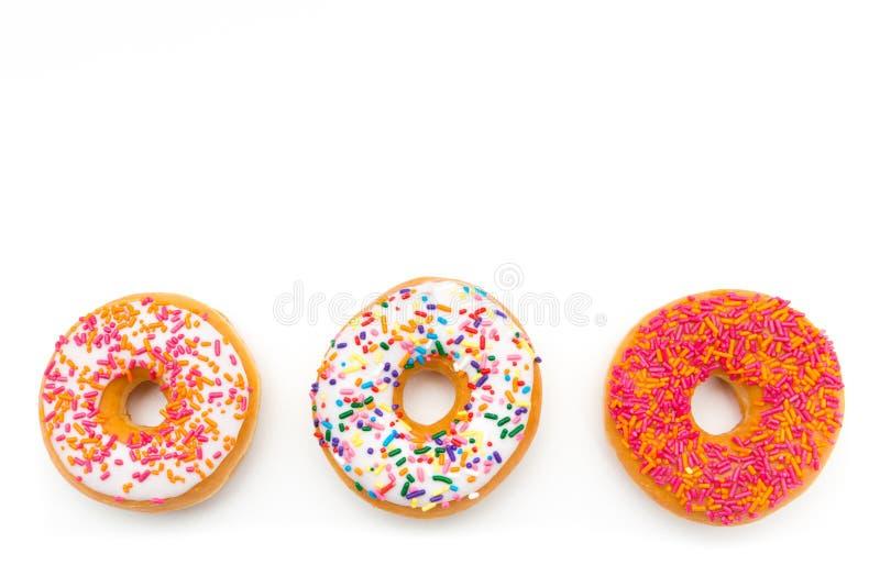 Kleurrijk doughnuttrio stock afbeelding