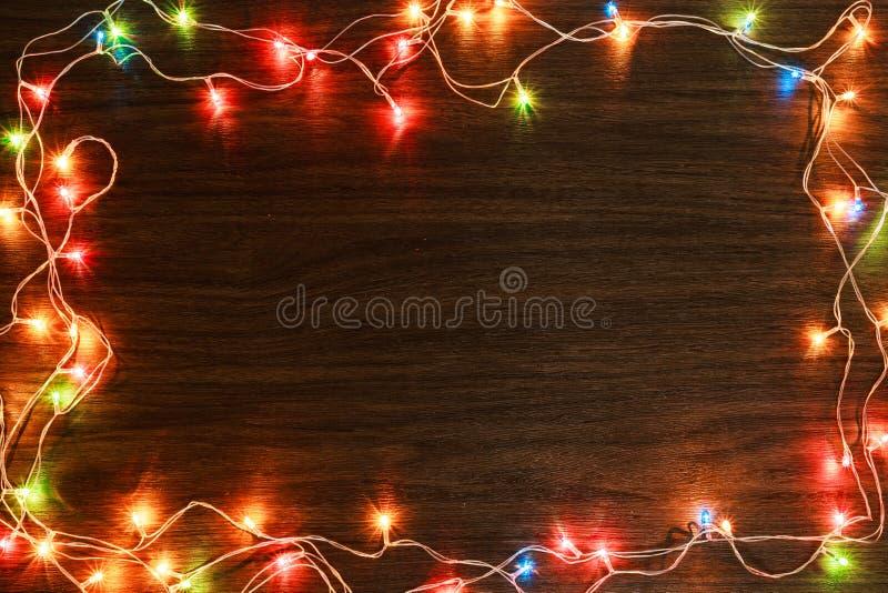 Kleurrijk licht op houten textuur voor Kerstmis royalty-vrije stock foto