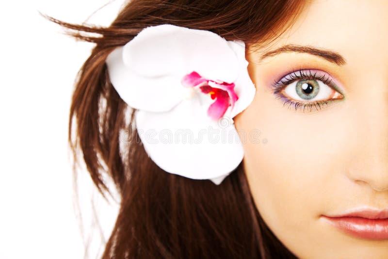 Kleurrijk oog half vrouwelijk gezicht royalty-vrije stock fotografie