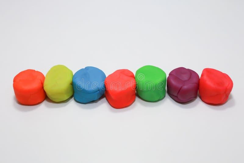 Kleurrijk playdough dicht omhooggaand beeld op witte achtergrond royalty-vrije stock fotografie