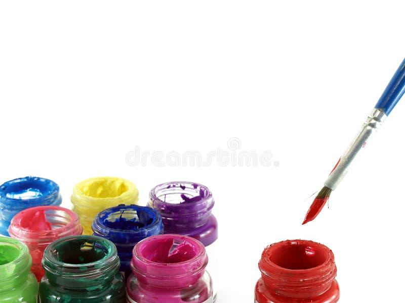 Kleurrijk van flessenplakkaatverf en penseel stock afbeelding