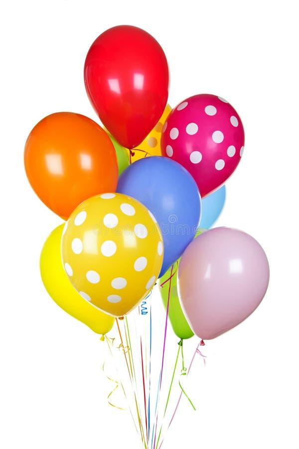 Kleurrijke ballons op wit stock foto's