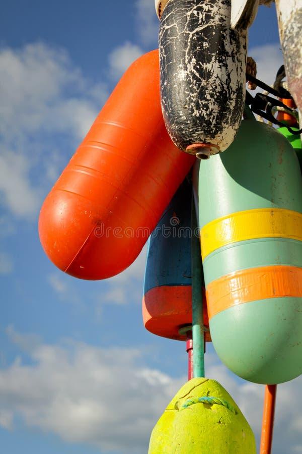 Kleurrijke boeien stock afbeeldingen