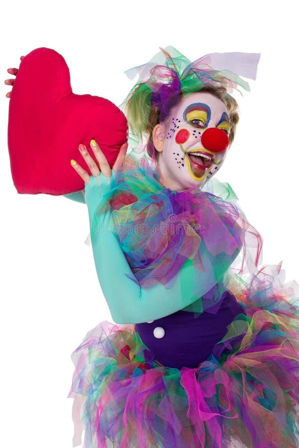 Kleurrijke clown met hart stock fotografie