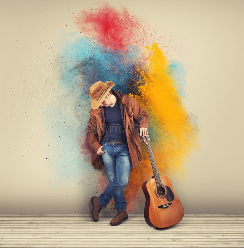 Kleurrijke cowboygitarist stock foto's