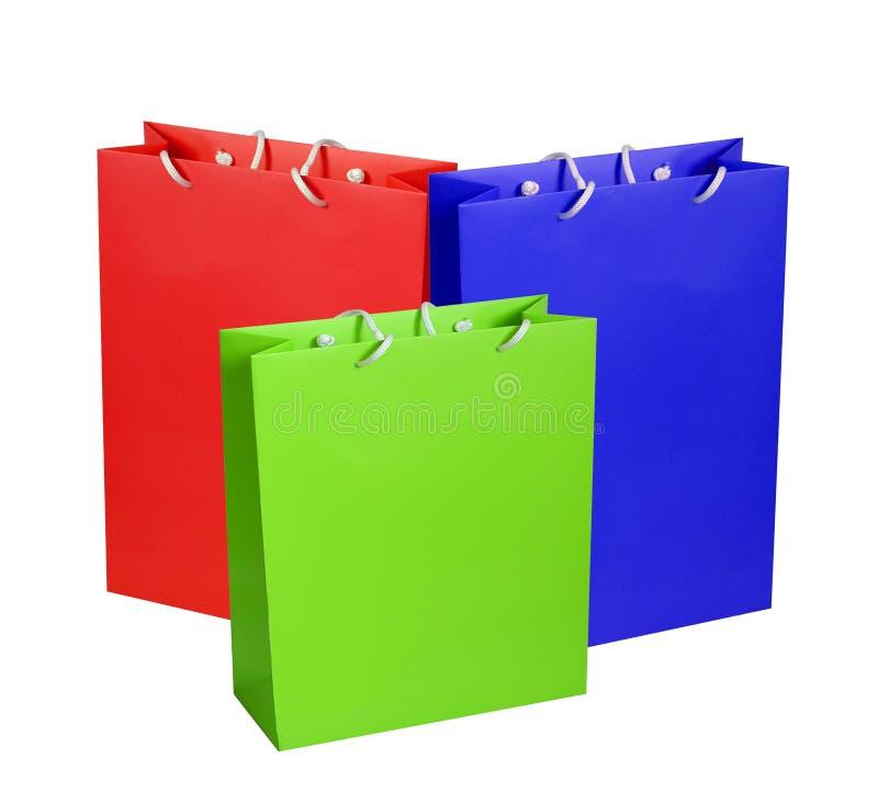 Kleurrijke die document het winkelen zakken op wit worden geïsoleerd stock afbeelding