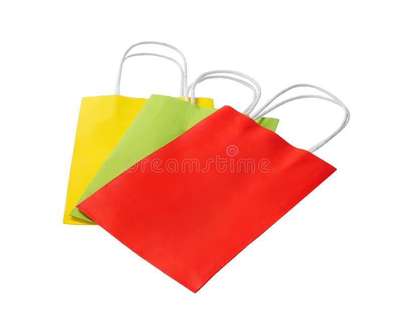 Kleurrijke die document het winkelen zakken op witte achtergrond worden geïsoleerd stock foto's