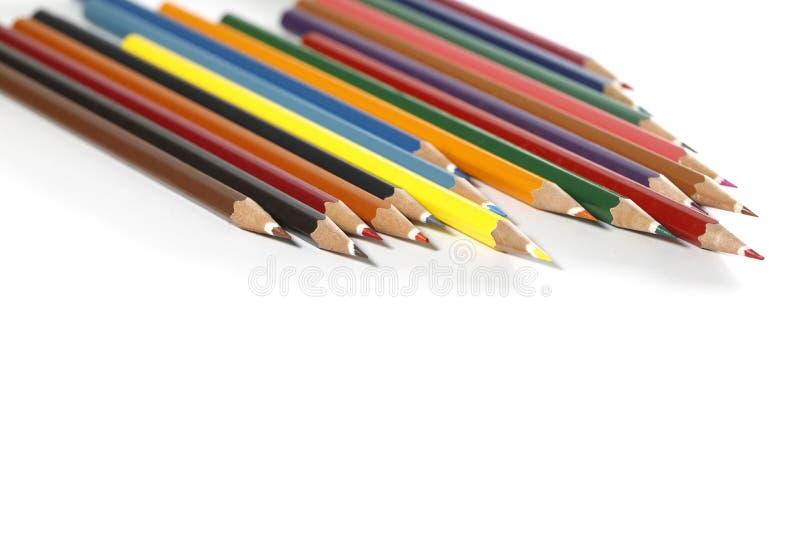 Kleurrijke die potloden op witte achtergrond worden geïsoleerd stock afbeeldingen