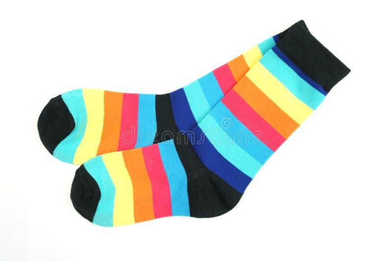 Kleurrijke die sokken op witte achtergrond worden ge?soleerd stock afbeelding