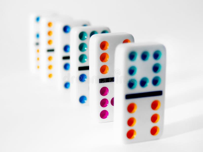 Kleurrijke Domino's stock afbeeldingen