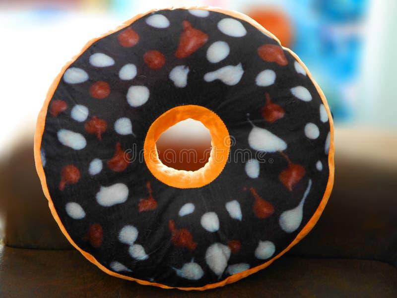 Kleurrijke doughnuthoofdkussens stock foto