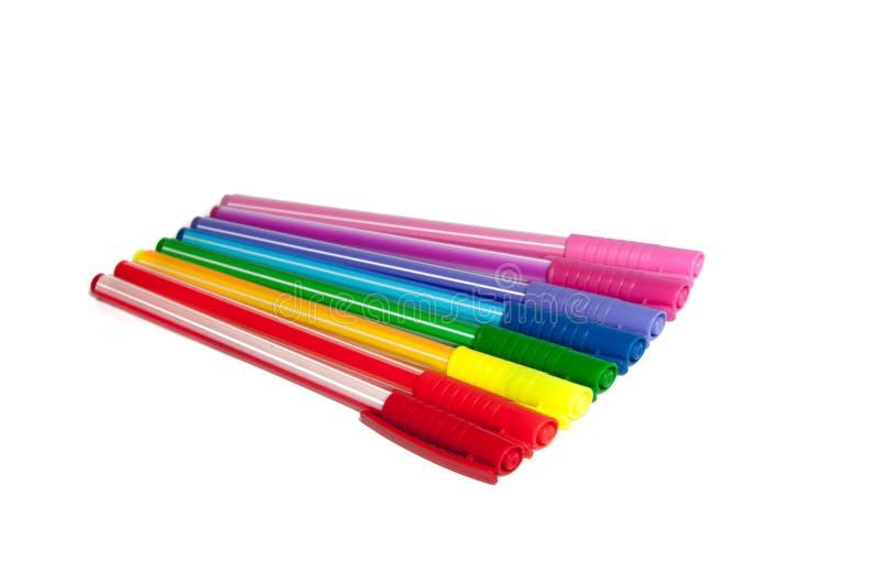 Kleurrijke geïsoleerde pennen of tellers royalty-vrije stock foto