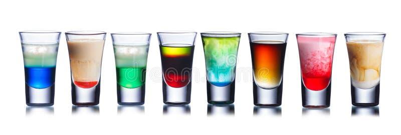 Kleurrijke geschotene die dranken op wit worden geïsoleerd royalty-vrije stock afbeeldingen