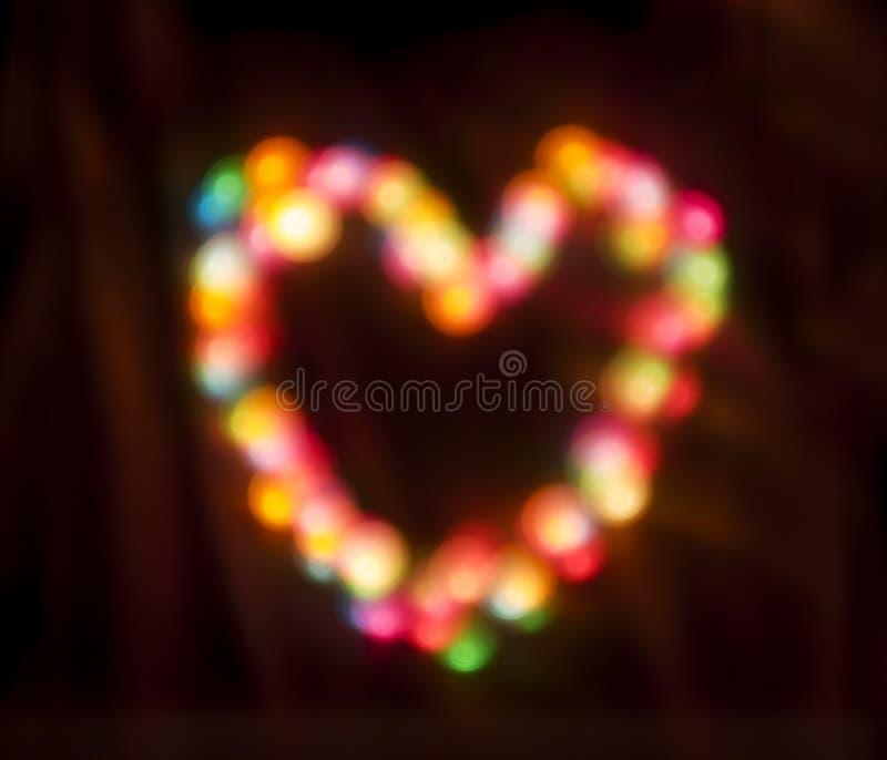 Kleurrijke gloeiende cirkels Bokeh op een donkere achtergrond royalty-vrije stock foto