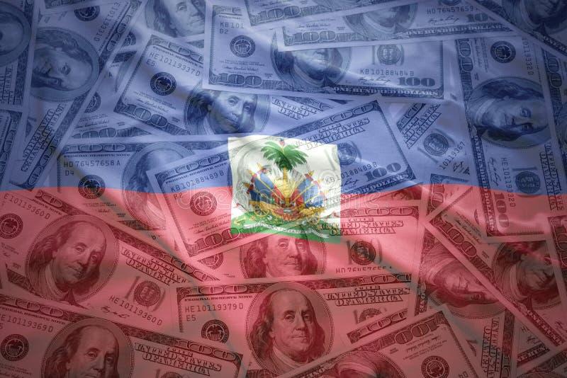 Kleurrijke golvende haitian vlag op een achtergrond van het dollargeld royalty-vrije stock fotografie