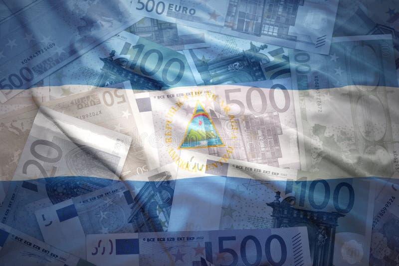 Kleurrijke golvende nicaraguan vlag op een euro achtergrond royalty-vrije stock afbeeldingen
