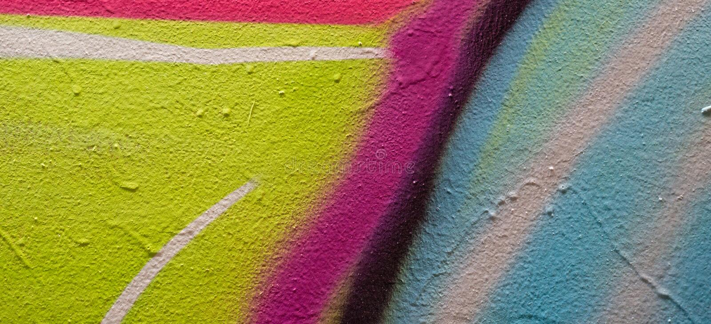 Kleurrijke graffiti die fragment op pleistermuur schilderen Straatkunst in de stad stock afbeelding