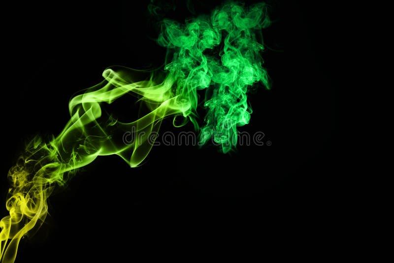Kleurrijke groenachtige rook stock afbeelding