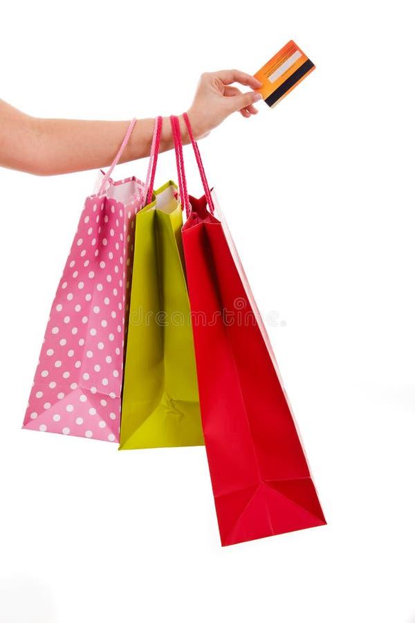 Kleurrijke het winkelen zakken en een creditcard stock foto