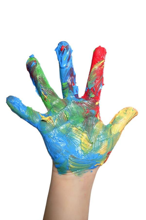Kleurrijke kinderenhand die over wit wordt geschilderd stock foto's