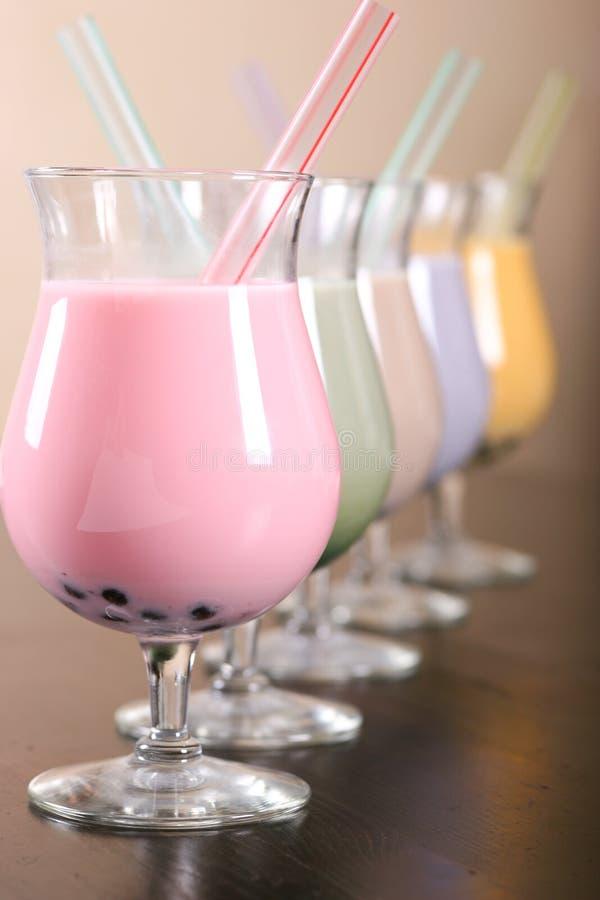Kleurrijke Milkshake stock afbeeldingen