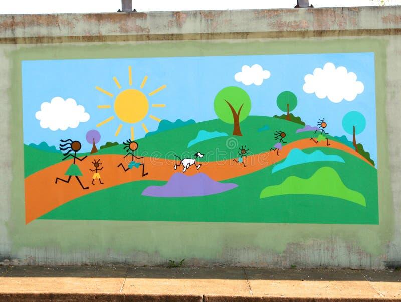 Kleurrijke Muurschildering van Kinderen die op James Road in Memphis, Tennessee spelen stock foto